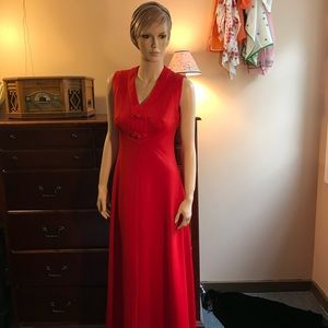 Red floor length sleeveless gown